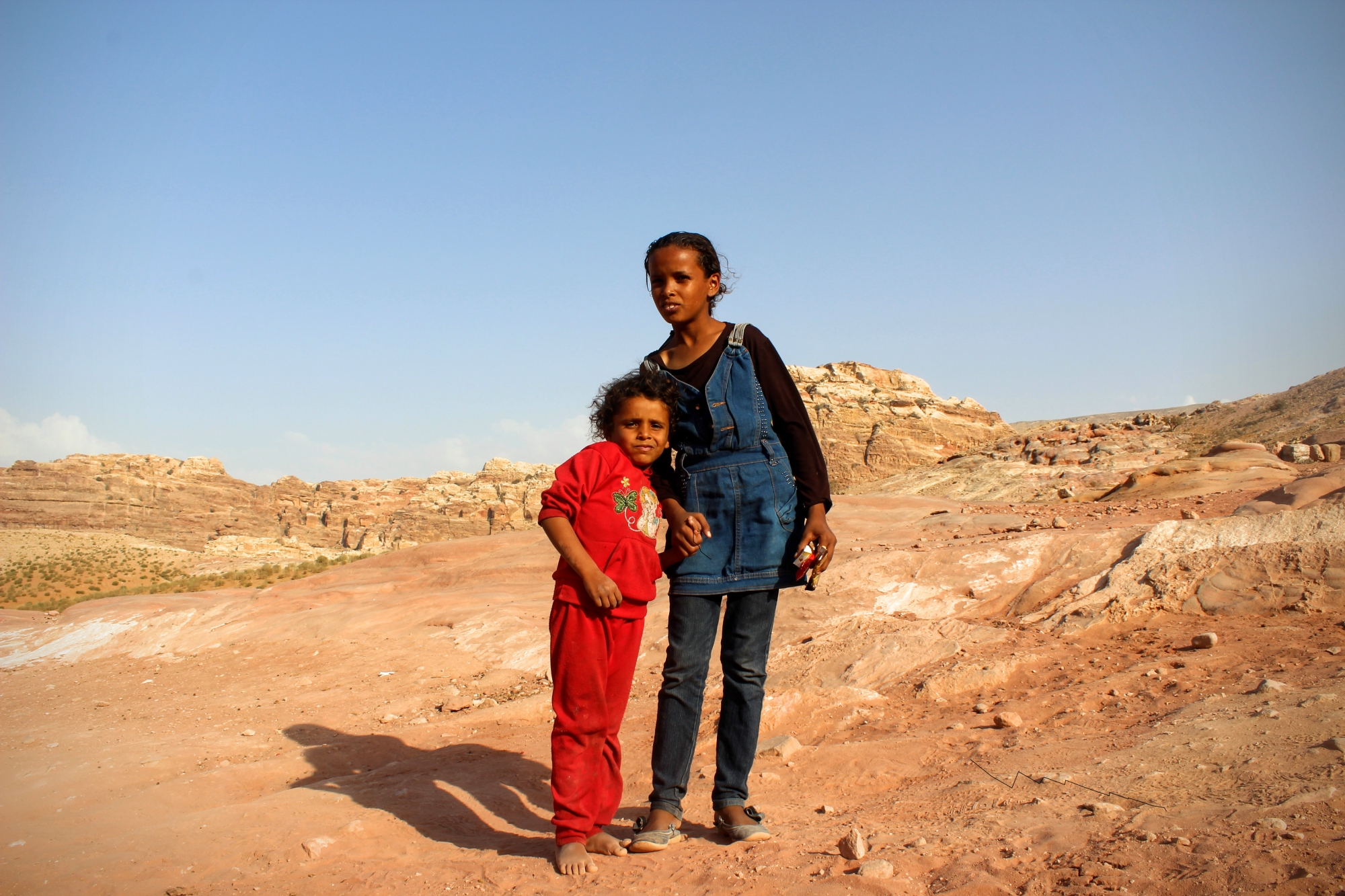 When the little Bedouin girl asked for money, her older sister told her to stop. We agreed on candy instead.