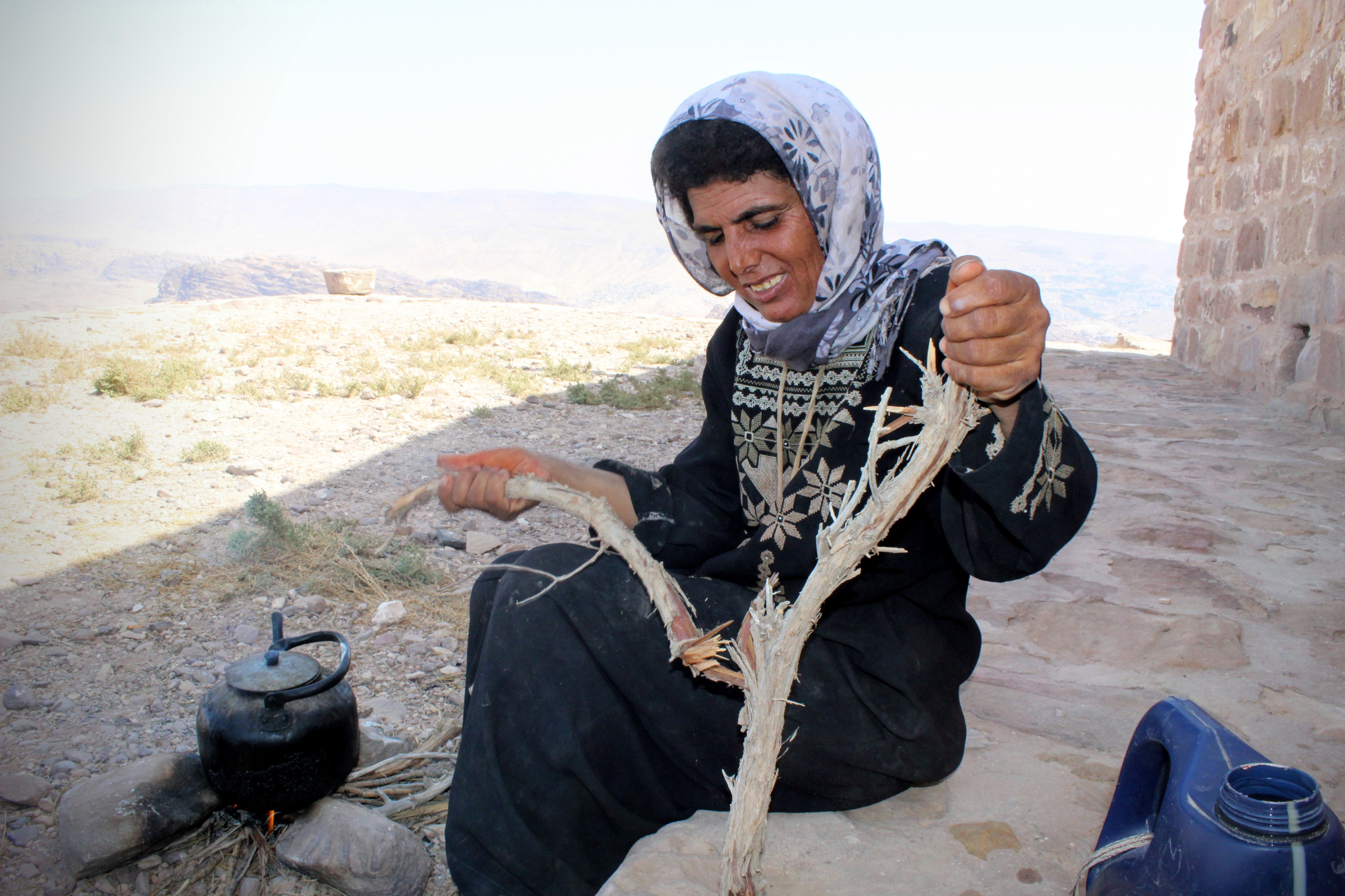 Bedouin woman holding wood